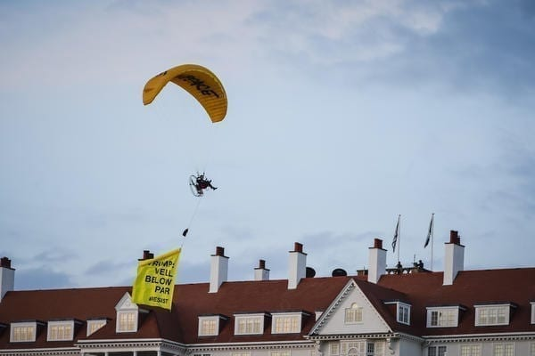 The paraglider circled the lawn in front of the Turnberry Hotel