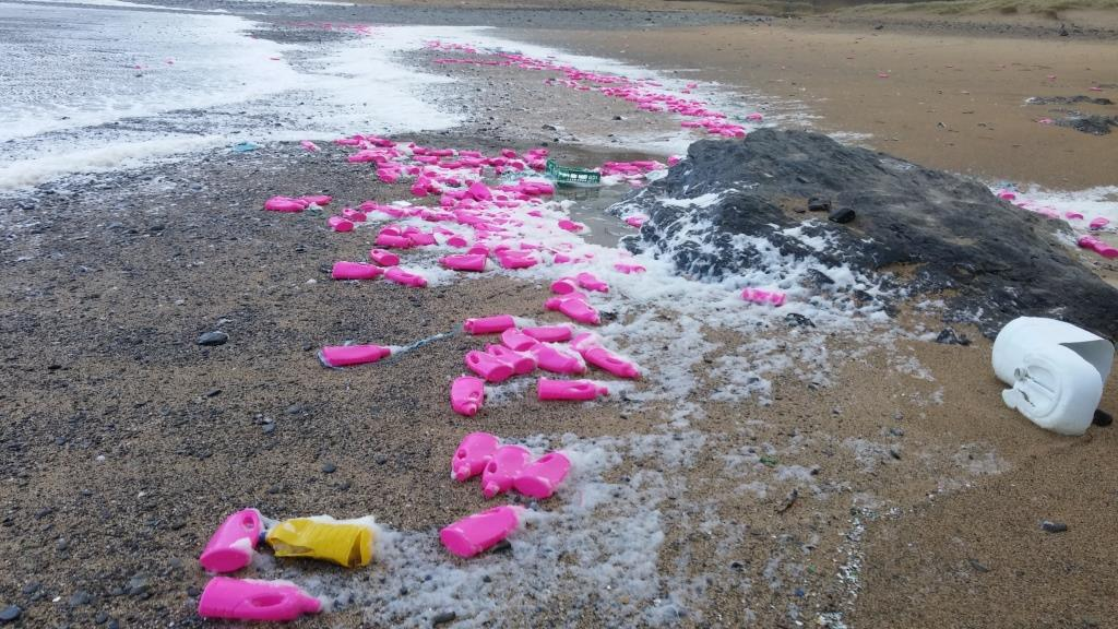 pink-bottles-on-poldhu-beach-in-cornwall1-1