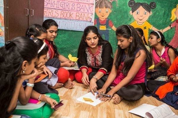 Aarti Naik with schoolgirls at Sakhi for Girls Education