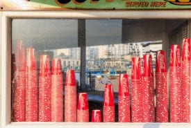 Coca-Cola cups at a kiosk on the Brighton pier